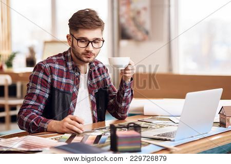 Freelancer Man In Shirt Drawing On Plan At Laptop Sitting At Desk.