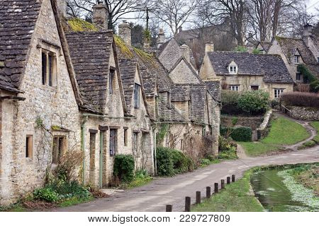 Houses of Arlington Row in the Cotswold village of Bibury, Gloucestershire, England