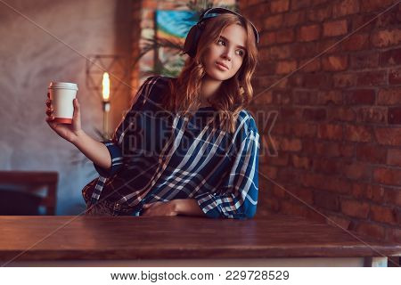 A Young Charming Sexy Girl In A Room With A Loft Interior.