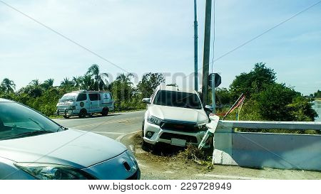 Pick Up Crashed Into The Electric Pole. Rescue Vehicle With Ambulance Ready To Help.