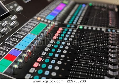 Closeup Of The Professional Audio Mixing Console. Selective Focus.
