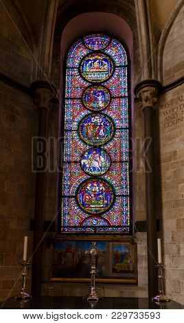 CANTERBURY, UK - JUN 1, 2013: Stained glass window of Canterbury Cathedral, one of the oldest and most famous Christian structures in England.  Canterbury, Kent Southern England, UK