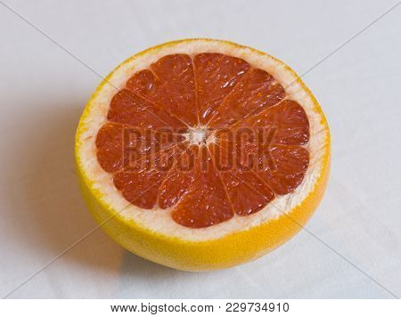 Half Red Grapefruit On White Background
