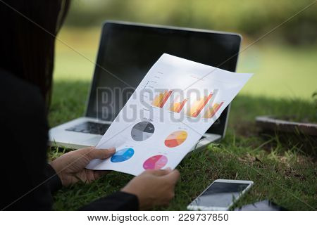 Young Beautiful Woman Working Outdoor In A Public Park. Working On Laptop Outdoors. Cropped Image Of