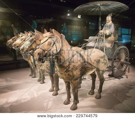 XIAN, CHINA - October 8, 2017: Famous Terracotta Army in Xi'an, China. The mausoleum of Qin Shi Huang, the 1st Emperor of China contains collection of terracotta sculptures depicting the armored men.