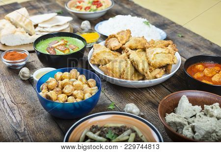 Indian And Pakistani Food On A Wooden Table
