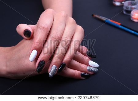 Black, White Nail Art Manicure. Holiday Style Bright Manicure With Sparkles. Beauty Hands. Stylish N