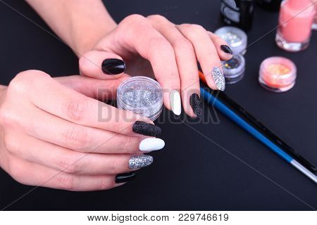 Black, White Nail Art Manicure. Holiday Style Bright Manicure With Sparkles. Bottle Of Nail Polish.