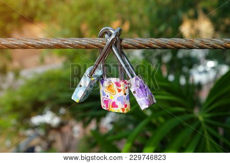Group Of Fancy Lock On The Sling Wire On Believe Of Forever Love