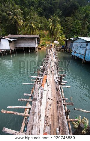 Pier made of wooden planks in the fishing village on Ko Chang island, Thailand.