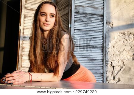 Beautiful Girl Leaned On White Grand Piano On Folding Screen Background.