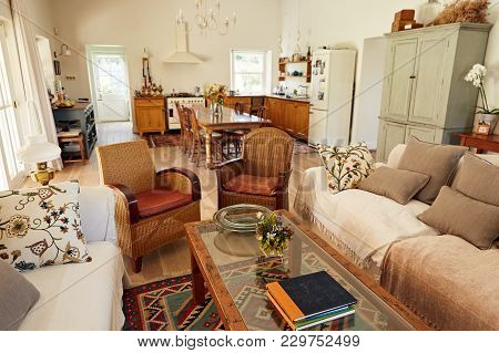 Interior Of A Living Room With A Sofa And Chairs In A Country Style Residential Home With The Kitche