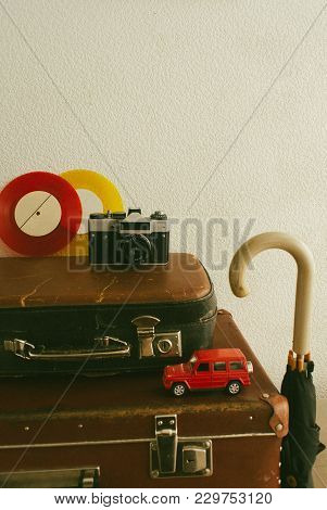 Part Of Leather Travel Valises Or Old Suitcase With Camera, Toy Car, Vintage Vinyl Records And Black