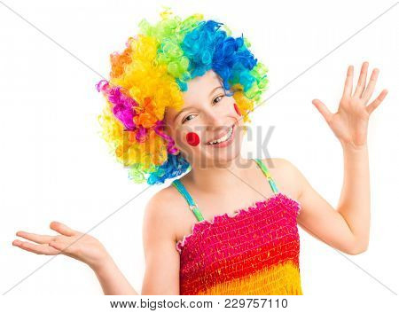 Little girl in funny clown wig with red spots on her cheeks isolated on white background
