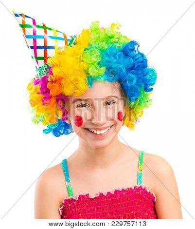 Funny little girl in clown wig with red spots on her cheeks isolated on white background