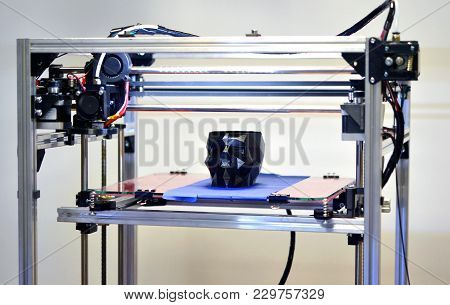 3d Printer Printing A Model In The Form Of Black Skull Close-up. The 4ht Industrial Revolution. Auto