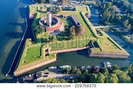 Medieval Wisloujscie Fortress With Old Lighthouse Tower In Port Of Gdansk, Poland A Unique Monument