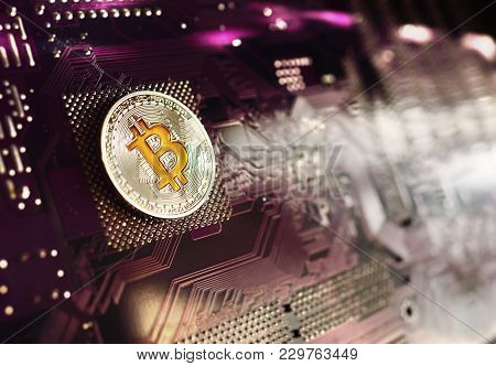 Silver Coin Bitcoin On A Microchip Background. Crypto Currency, Electronic