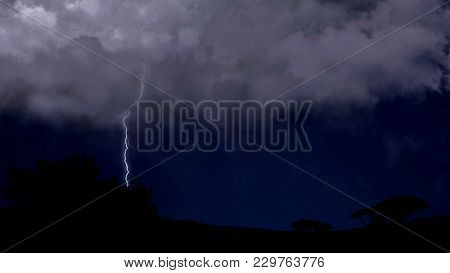 Electric Firebolts Strike From Clouds To Ground In Desert Countryside, Weather, Stock Footage