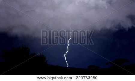 Dramatic Nature Background, Electric Firebolts Strike From Clouds To Ground, Stock Footage