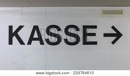 White Concrete Wall On Which Is Written In German The Word Cashier (kasse)