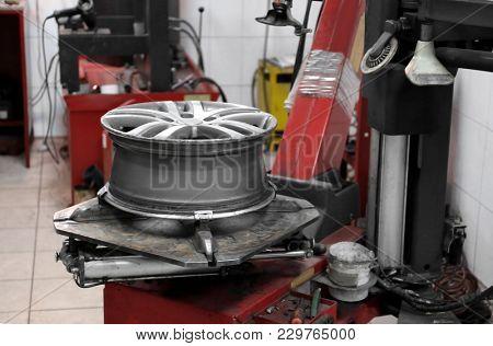 Alloy wheel in workshop of modern tire store