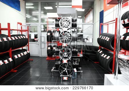 Modern store with alloy wheels and tires, indoors