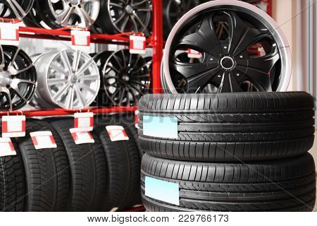 Car tires and alloy wheels in automobile store