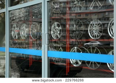 Showcase with tires and alloy wheels in modern store