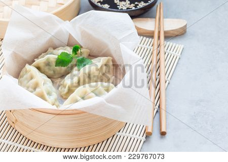 Steamed Korean Dumplings Mandu With Chicken Meat And Vegetables In A Bamboo Steamer, Horizontal, Cop