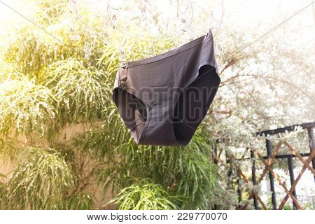 Black Underwear Is Hanging On The Clothes Rack