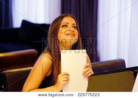Happy Brunette Enjoying Good News In Written Notice. Euphoric Girl Happy After Reading Good News In