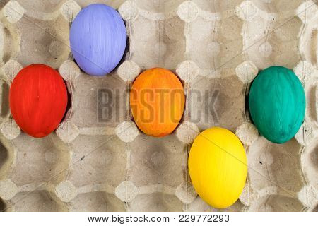 Happy Easter Card. Colorful Easter Eggs On Carton Background. Copy Space For Text