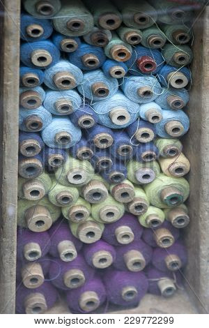 Spools Of Thread In A Box For Sale In A Shop Window