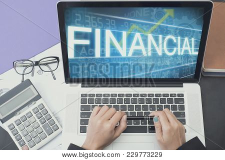 Business Accountant With Computer Screen Financial Text On Office Table. Concept Business Finance.