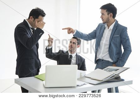 Business Team Point People Mistake Of Work.seriously Discussing Work As A Team In The Office.