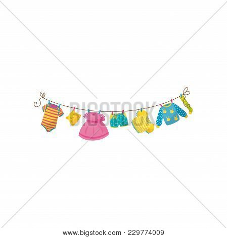 Baby Clothes Hanging On Rope. Striped Bodysuit, Little Cap With Ears, Pink Dress, Shorts, Blouse, Wa