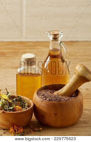 Beautiful Still Life Of Two Transparent Glass Oil Jars, Wooden Pestle And Mortar With Colorful Motle