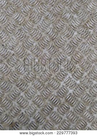 photo of dirty steel diamond plate texture