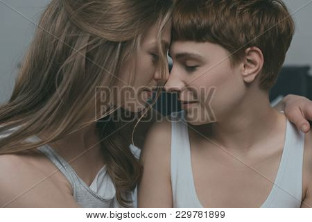 close-up hot of young cuddling lesbian couple poster