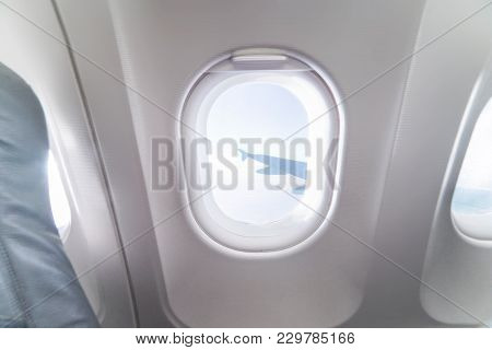 Airplane Window View Inside An Aircraft. Window Plane. Vacation Destinations Concept. Clouds And Sky