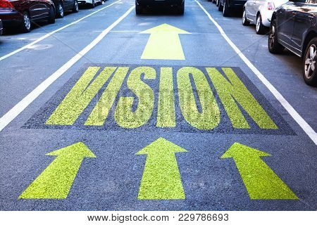 Vision Concept With Vision Word And Yellow Arrows On Road