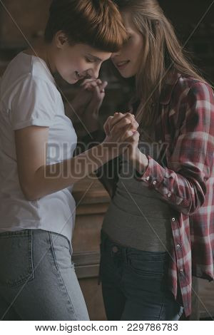Happy Young Lesbian Couple Dancing And Holding Hands