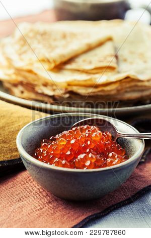 Red Salmon Caviar With Pancakes On The Background