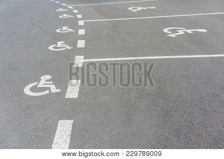 Handicapped Parking Sign On Asphalt Reserved In The Rest Area , France