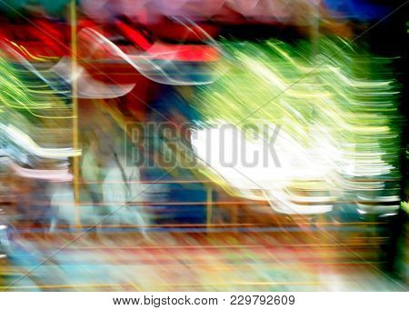 Carousel Ride Attraction Motion In Blur Child On White Horse