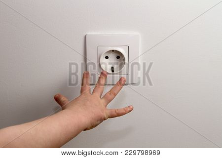 Electrical Security For Safety Home Of Ac Power Outlet For Babies, Baby Hands Playing With Electric