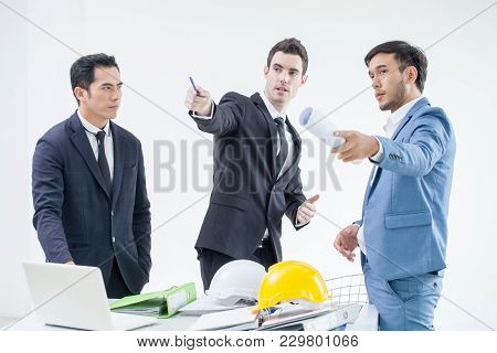 Team Of Business People And Architect And Engeneer Planning A Project In Office
