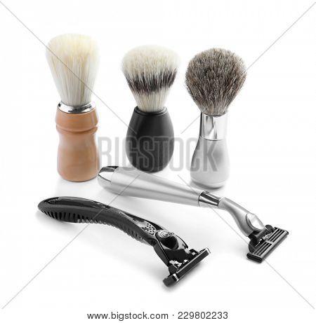 Shaving brushes and razors for man on white background