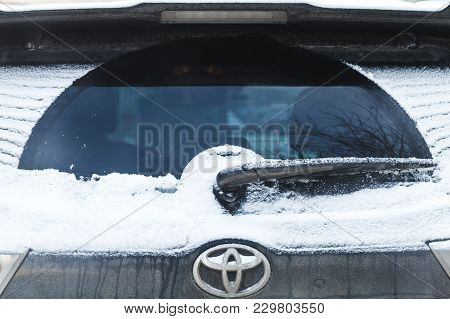 Saint-petersburg, Russia - February 27, 2018: Car Wiper On Rear Suv Window Covered With Snow In Cold